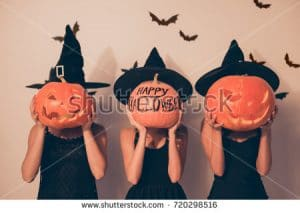 stock-photo-trick-or-treat-welcome-to-nightmare-three-mystical-ladies-worlocks-with-jackolanterns-in-black-720298516-1.jpg
